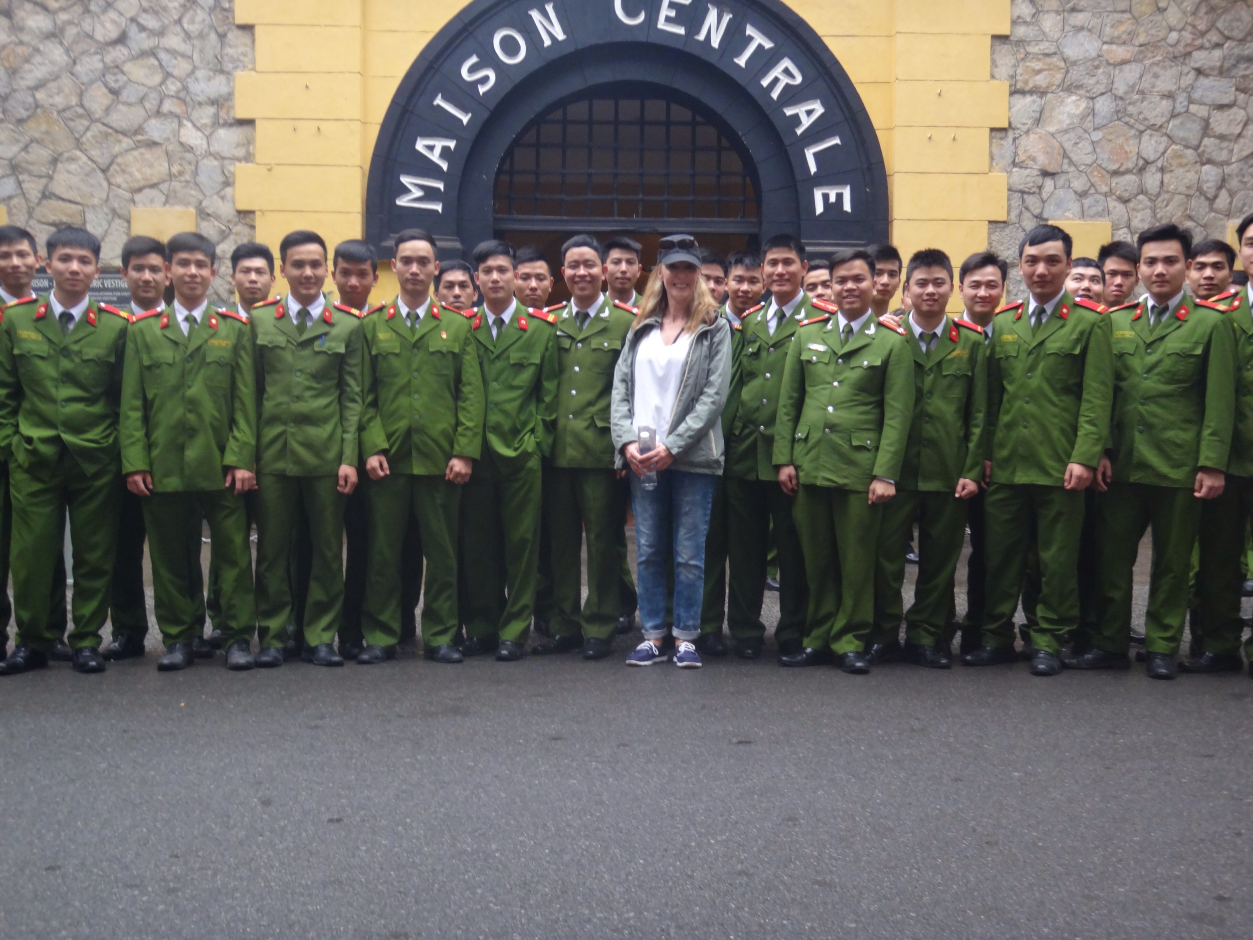 Me with new recruits to the Vietnamese police, outside the original gates of Hoa Lo Prison (literally translated as 'fiery furnace').  Named Maison Centrale (Central House) by the French and called the 'Hanoi Hilton' by American prisoners of war.