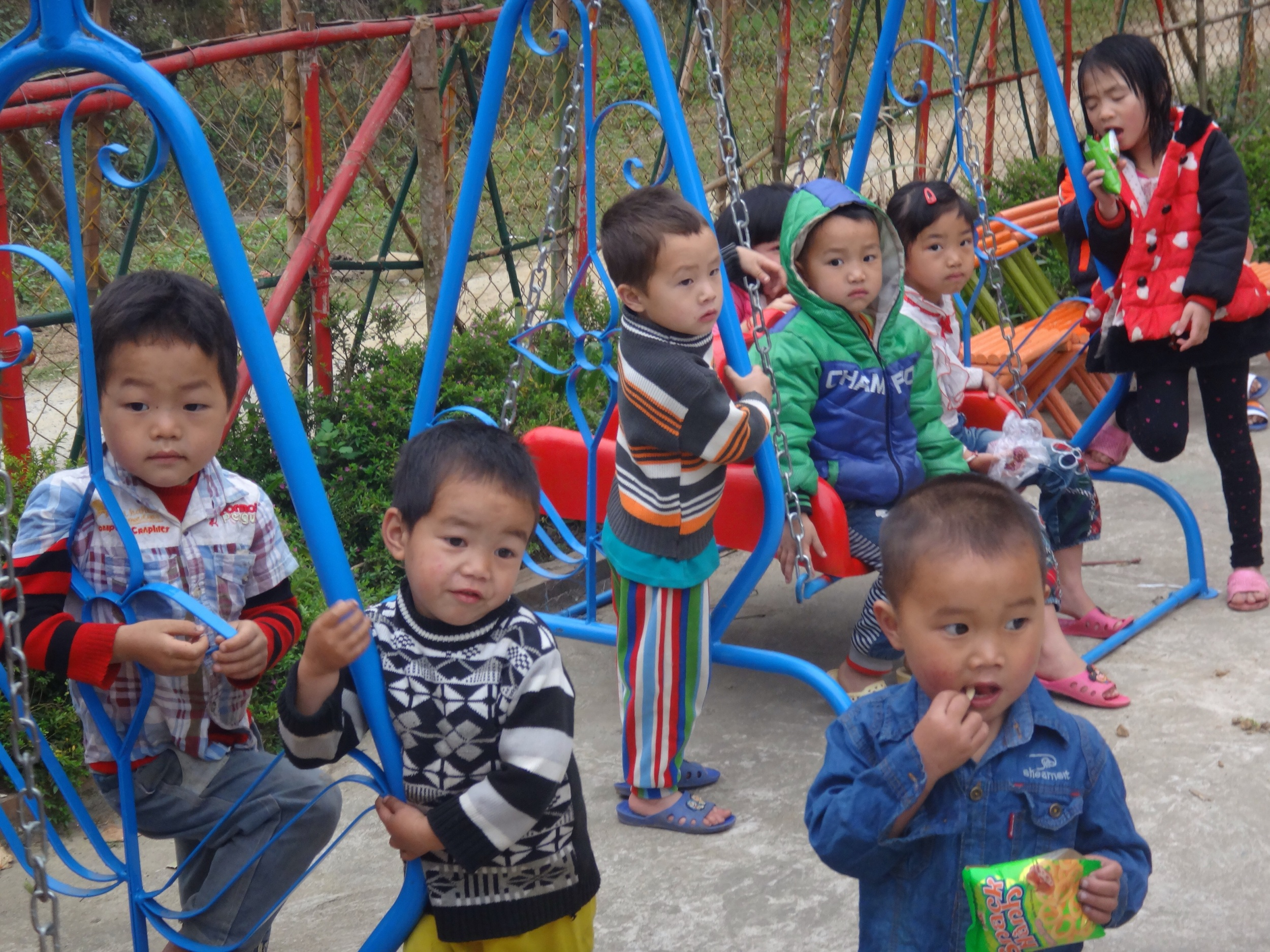 Walked into the village before breakfast -- kids at the kindergarten.  In this area, education was free until high school which the cost of attending exceeded the abilities of almost all of the ethnic peoples to pay.