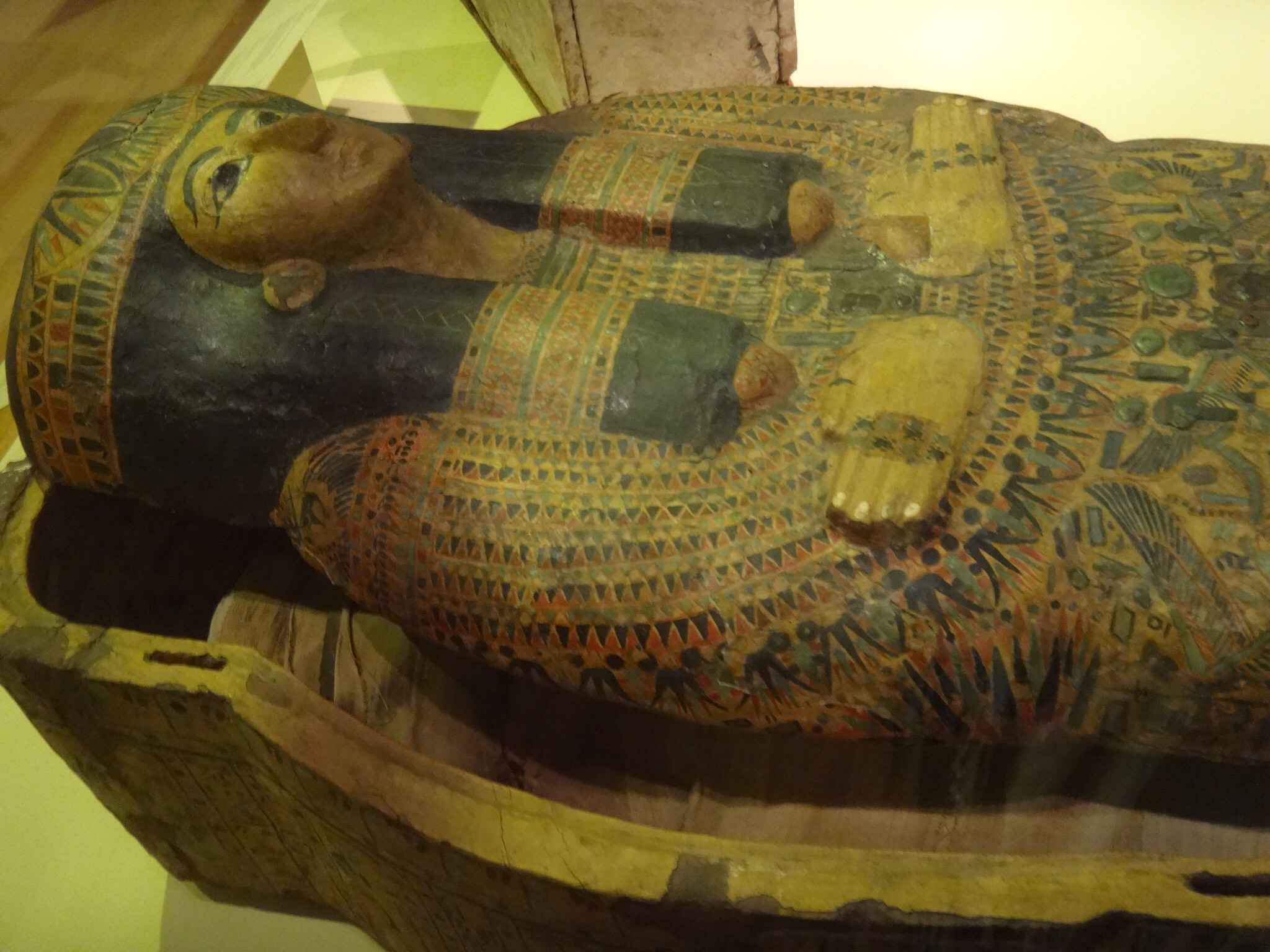 Egyptian sarcophagus with cloth wrapped mummy inside