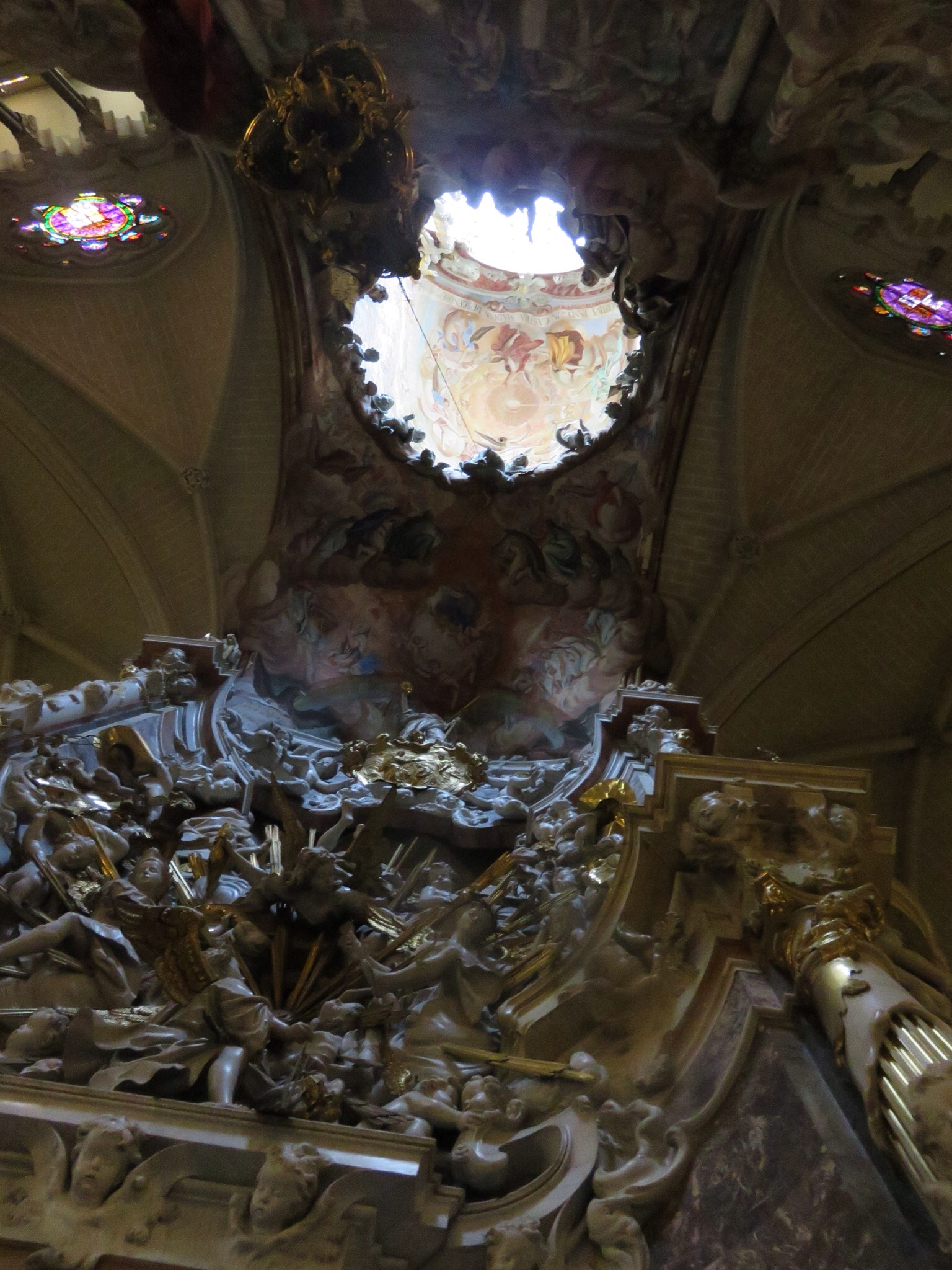 The'Transparente', unique to the Cathedral, a 'skylight' was cut in the ceiling in the 1700's to allow sunlight for Mass.   Carved out of marble, it faces east to catch the morning sun.