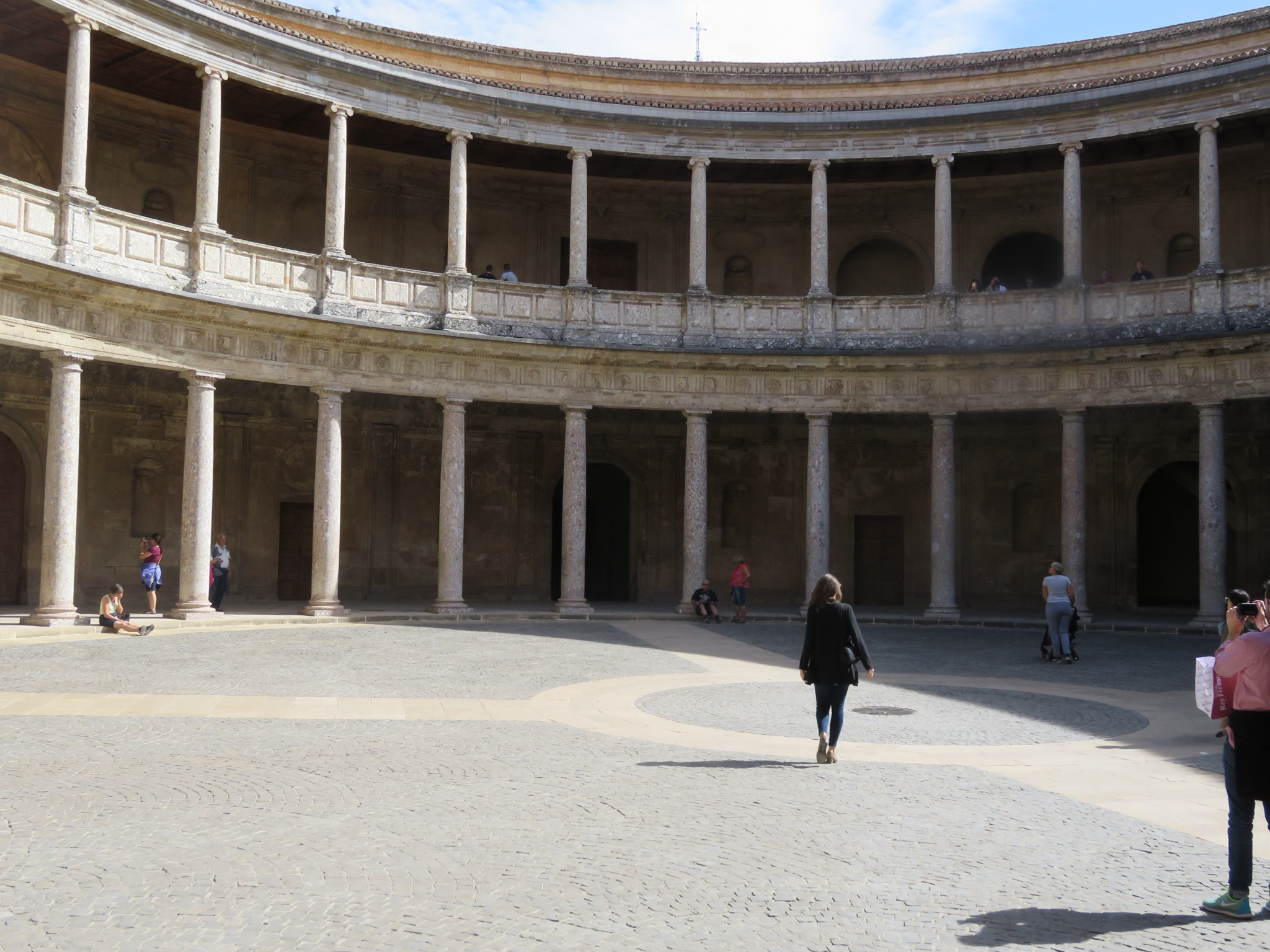 Charles V Palace -- left his mark by building a Renaissance palace for official functions but lived in the Moorish Palacios Nazaries.   This palace was a square on the outside and circle on the inside.