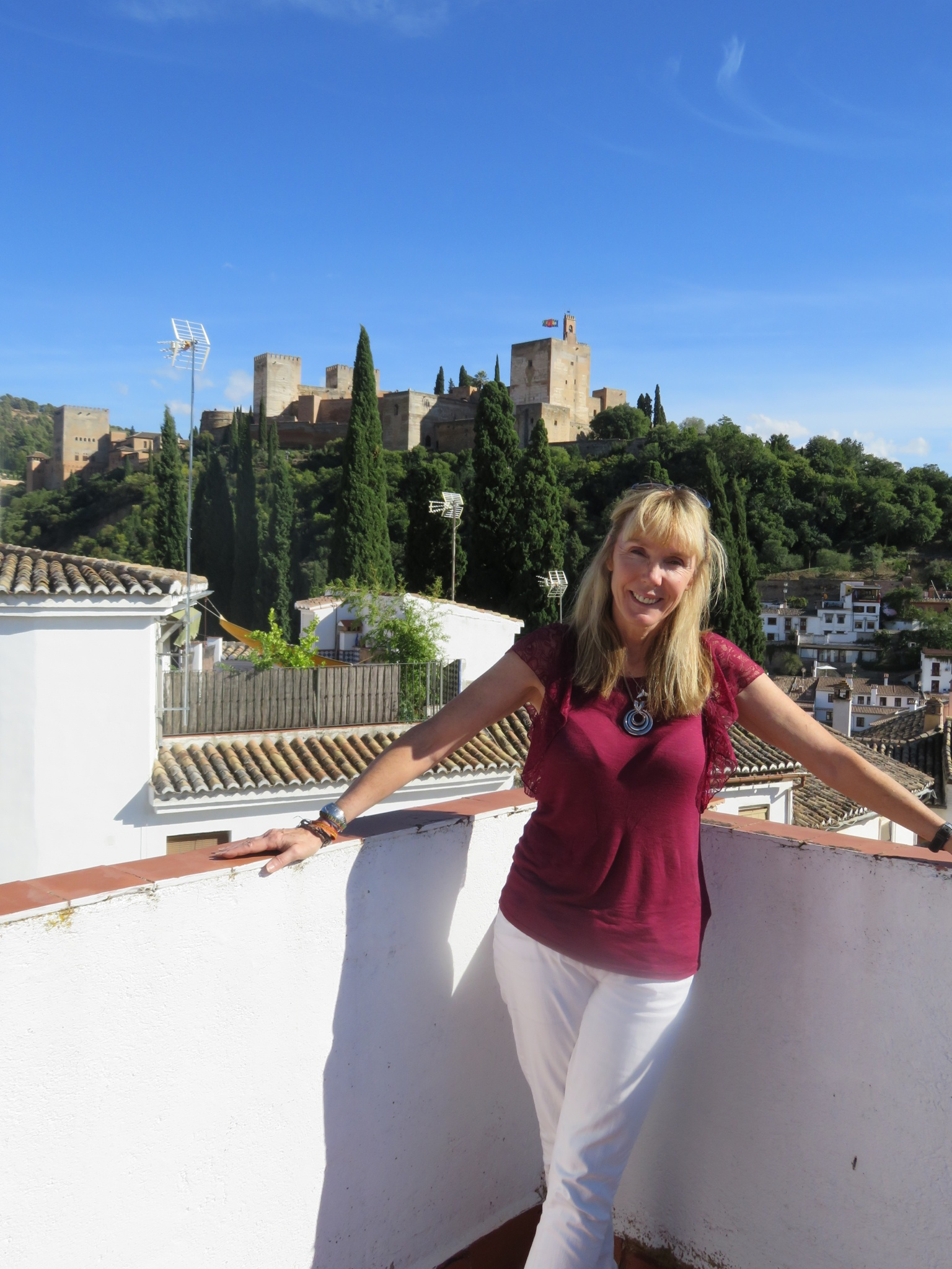 Terrace of the house with the Moorish Alhambra fortress and palace in the background.