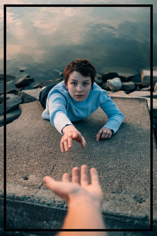 Child falling down rock.jpg