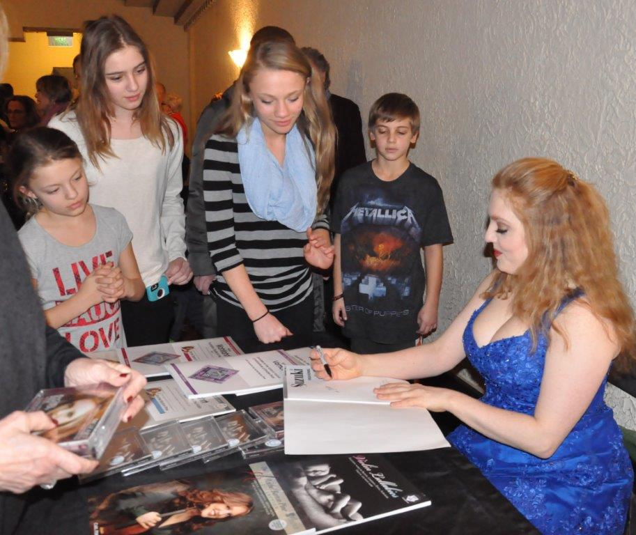 Rachel Barton Pine signs music and CDs after her performance on January 27th