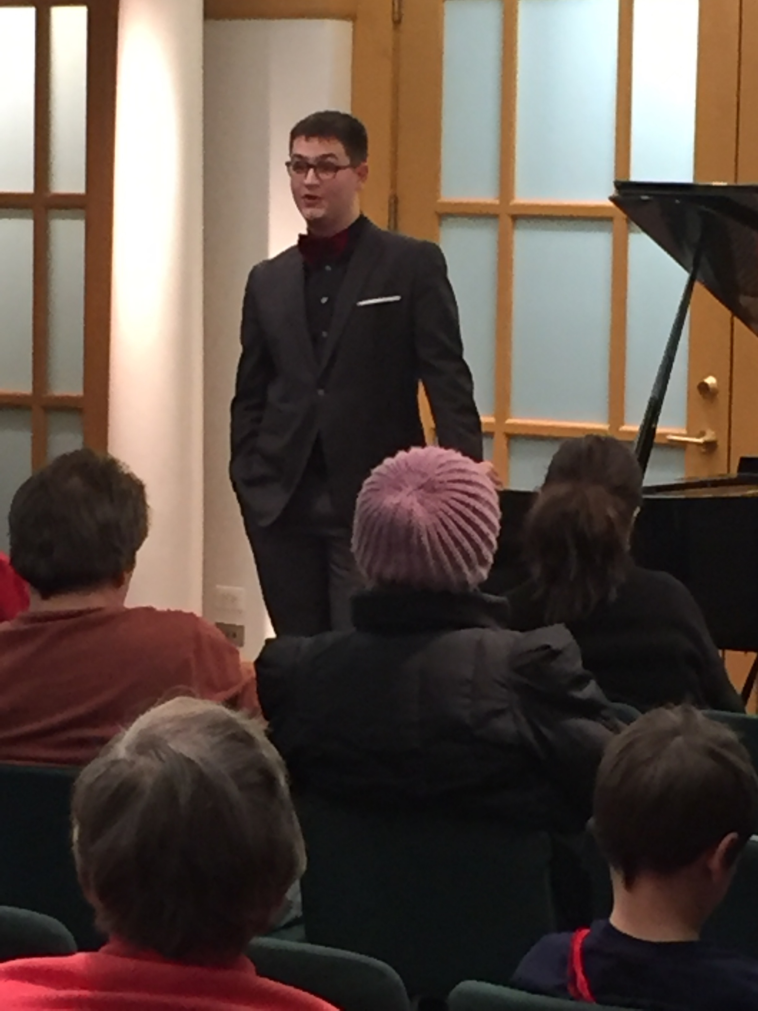Ethan Valentin addresses the crowd at his piano recital