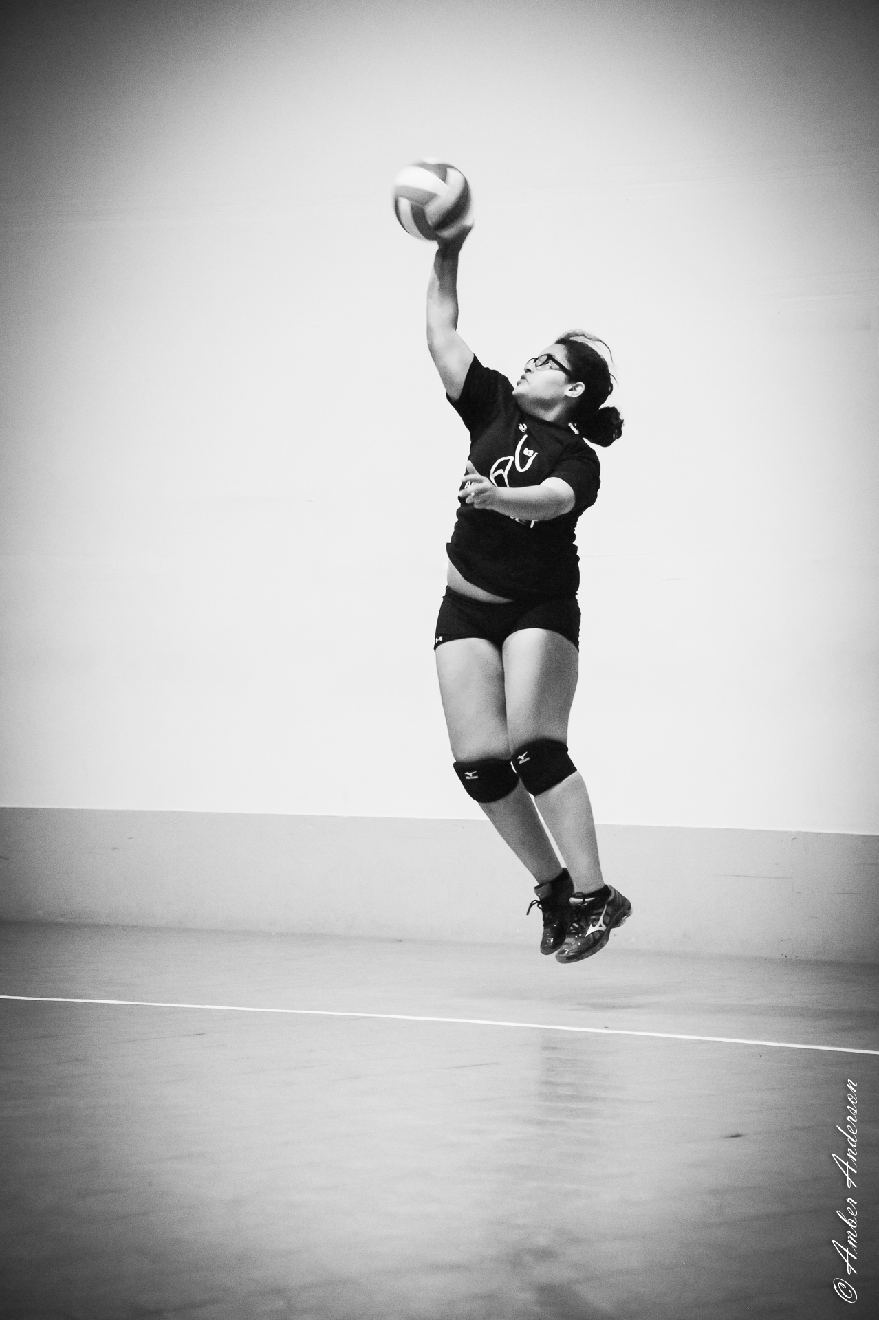 Jump Server Daja Jackson style.  She's got skillz!  Taken at Aspire Volleyball Club in Phoenix, AZ.