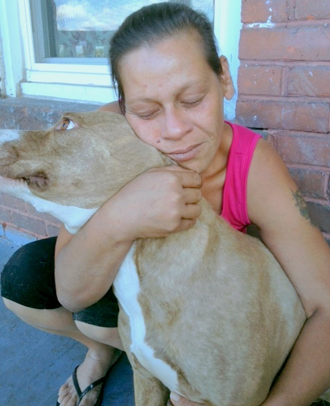 Jaqueline, Nena's companion, shares a special moment with her dog.
