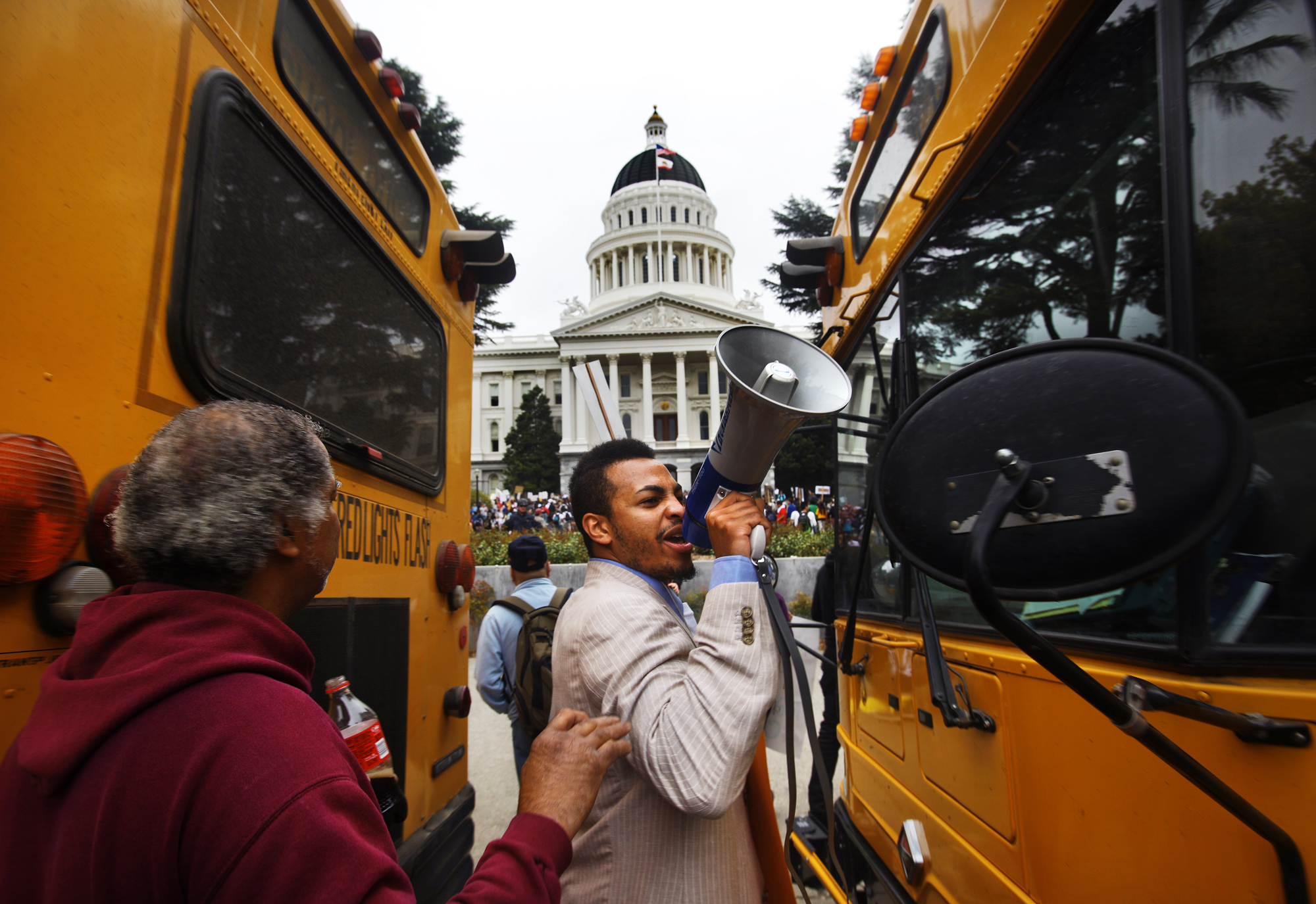 """Foothill College Student Rights Officer Etienne R. Bowic leads students towards California's Capitol building in Sacramento, cheering """"SOS, save our schools"""" and """"Our people, our nation, we need an education."""" Thousands bused statewide to protest cuts to state's cash-strapped community colleges on March 22, 2010."""
