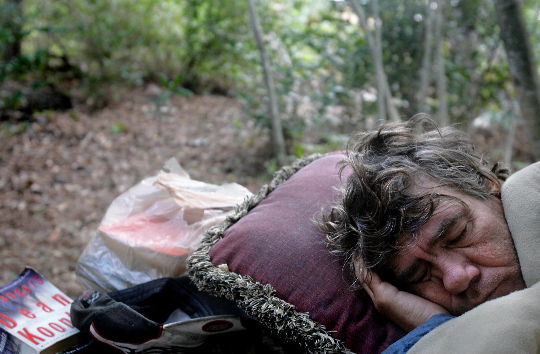 Del, a homeless man in Naples, Florida, finds shelter in the woods behind a shopping center.