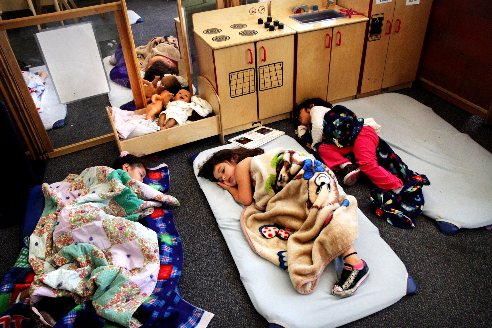 Itzel, center, rests during naptime at the Haven Family House, Thursday, May 12, 2011. The Haven Family House serves as a transitional home for at-risk families, they face major budget cuts.