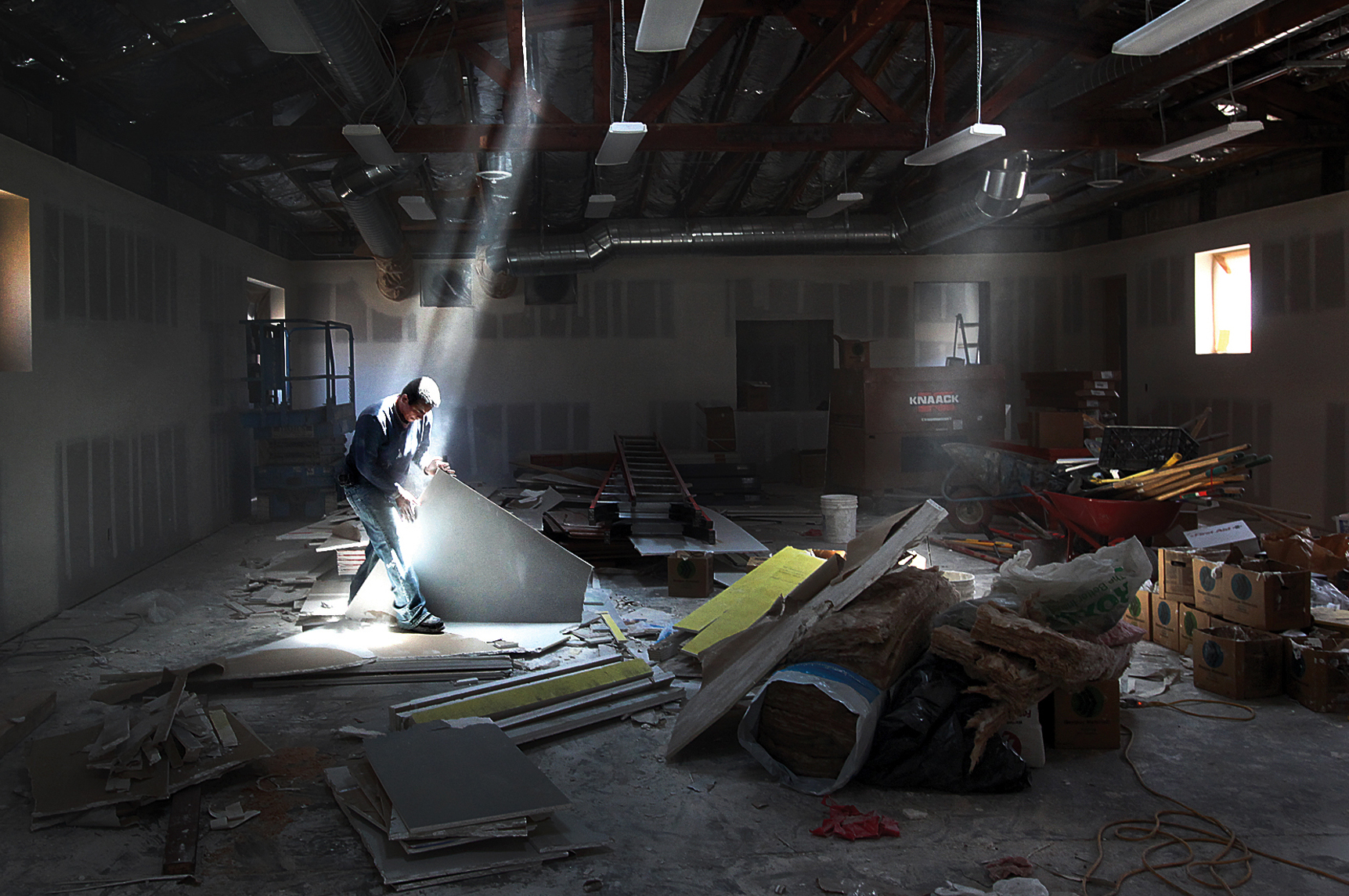 Jose Oriana sorts through left over dry wall inside the Day Worker Center of Mountain View,as major construction nears completion.