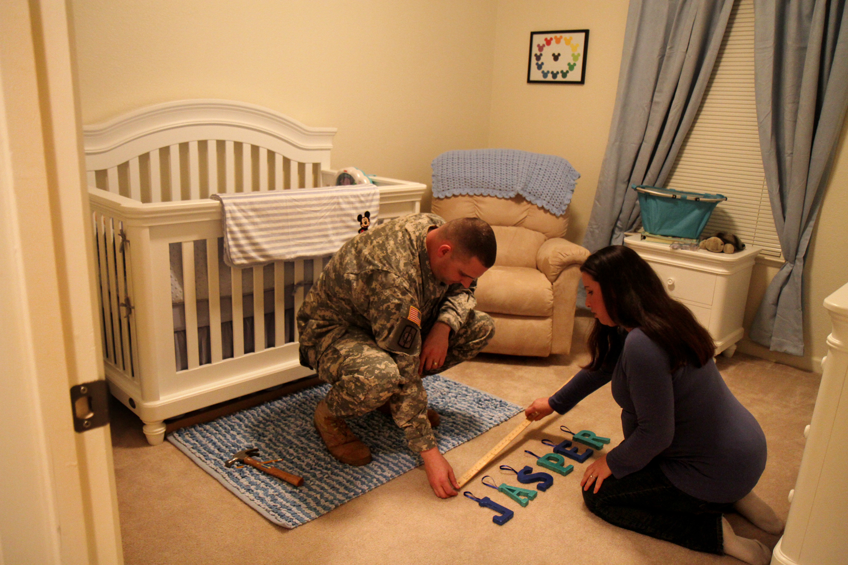 Jason and his pregnant wife Shelby prepare their baby's room, while living on base. TCE was found in sections of base housing. Exposure during pregnancy can lead to birth defects.