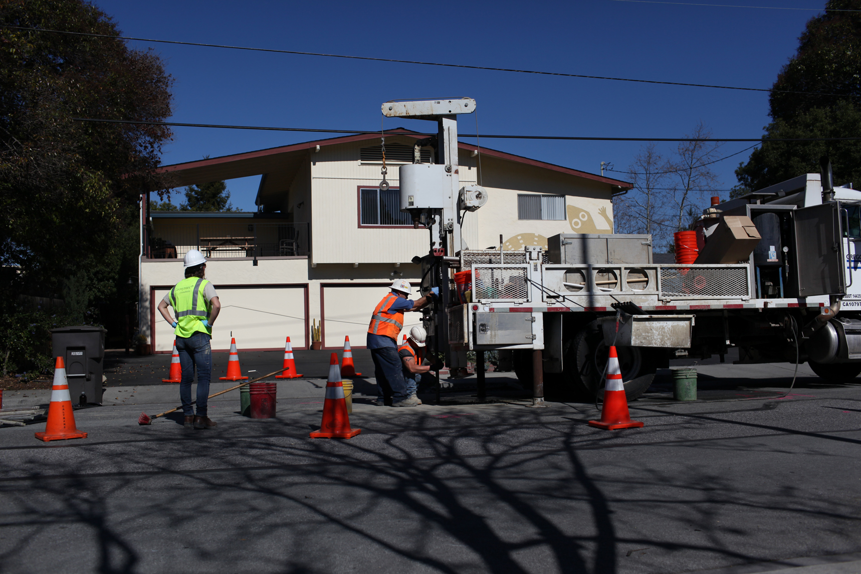 Contract workers drill 36 feet deep to collect water samples for TCE contamination testing, in front of an apartment complex located at 250 Evandale Avenue, Feb. 14, 2013. Currently, landlords are not legally obligated to inform tenants of the toxin levels found in their units. Tenants are not allowed to get free testing by the EPA without landlord consent.