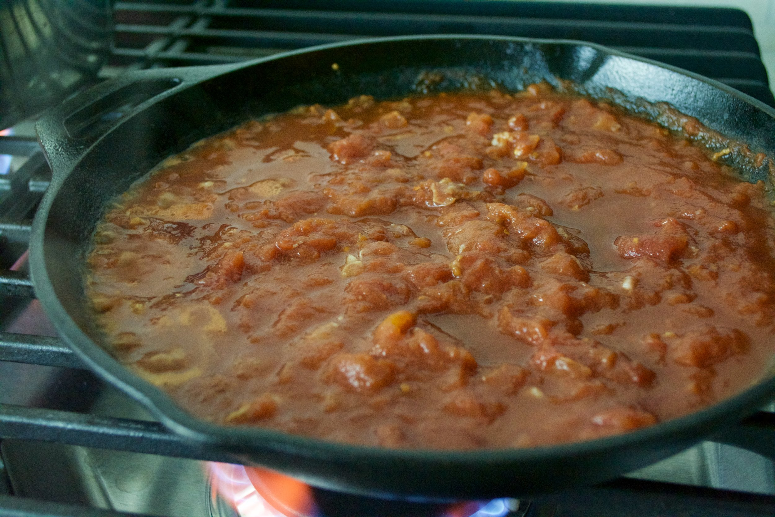 Simmering tomato and spice.