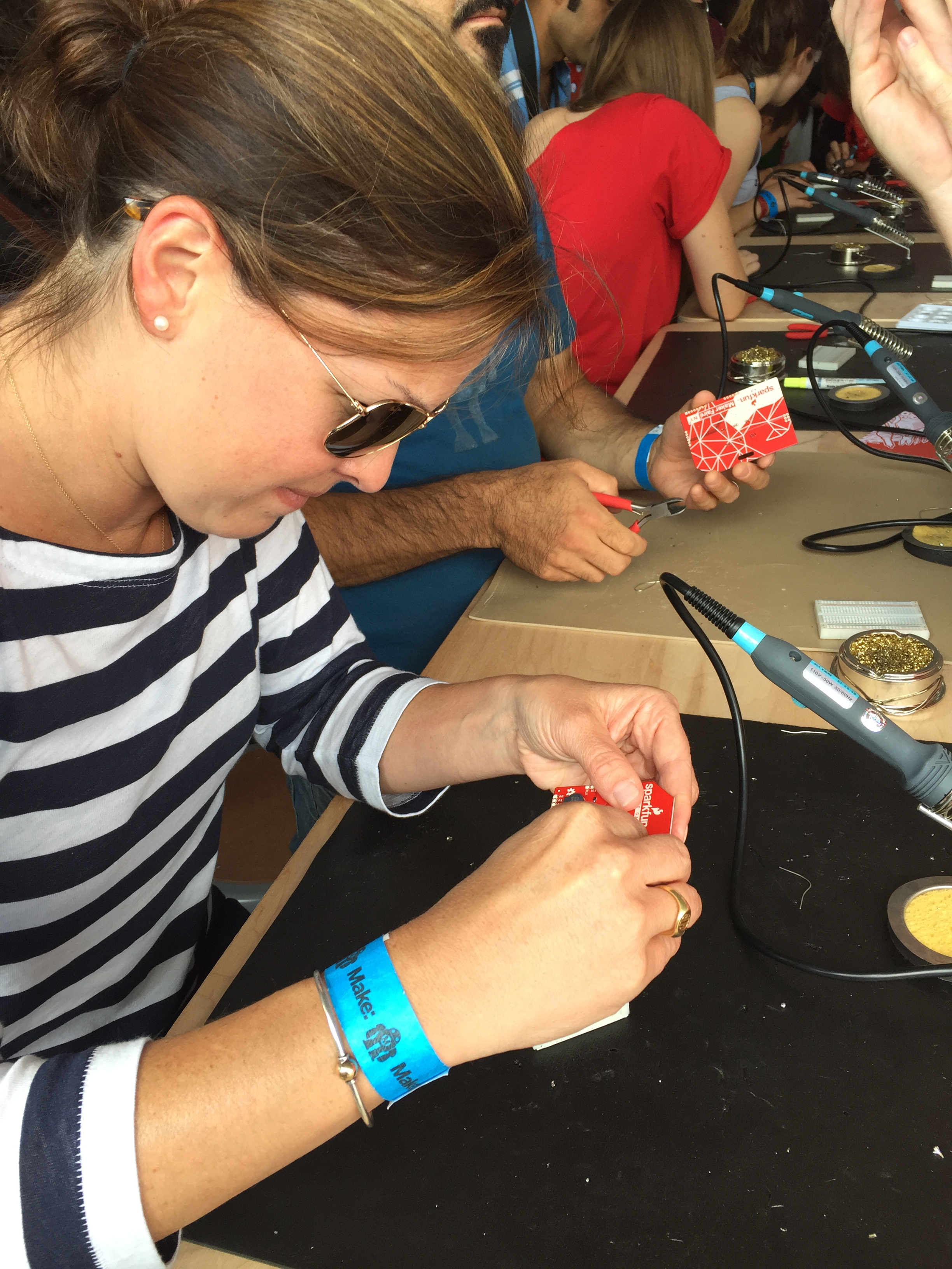 Soldering a name badge at Makerfaire.