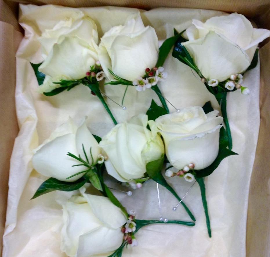 Claudia buttonholes winter rose.jpg
