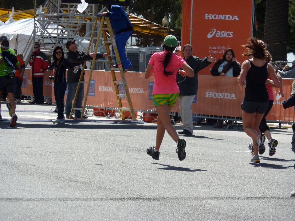 LA Marathon// 2012- the finish looked better than the last six miles..... also my hair made itself into one big dred.
