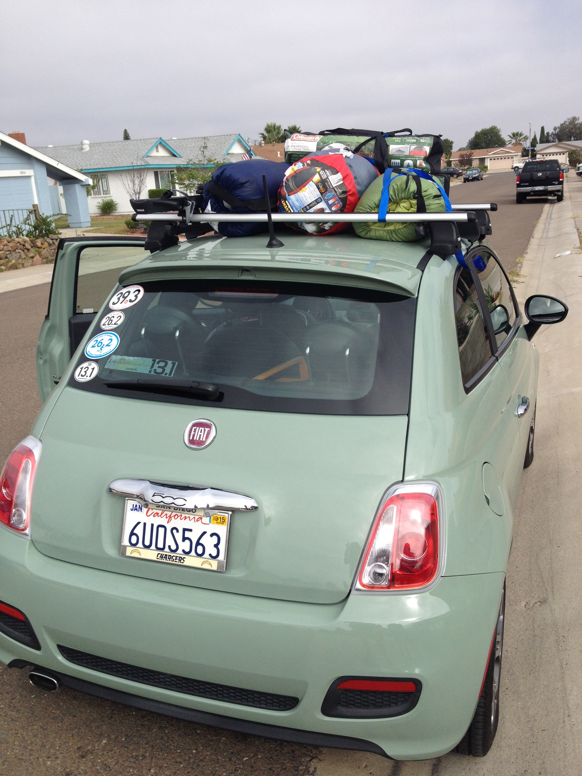 the lil FIAT that could. 4 women. 2 tents. 6 gallons of water. 4 bags, 4 sleeping bags. 1 cooler. this is not a joke.