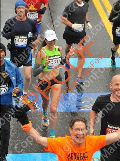 "i tried to muster a smileee. i love the guy in the orange's ""BOSTON FINISHER"" face though. that's how i'll look MY next boston."