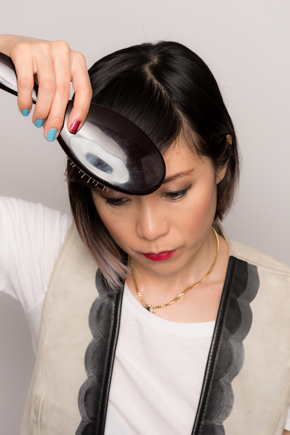 ROCK MAMA NYC LIFESTYLE BLOG - HOW TO STYLE SIDE SWEPT BANGS WITH A FLAT IRON
