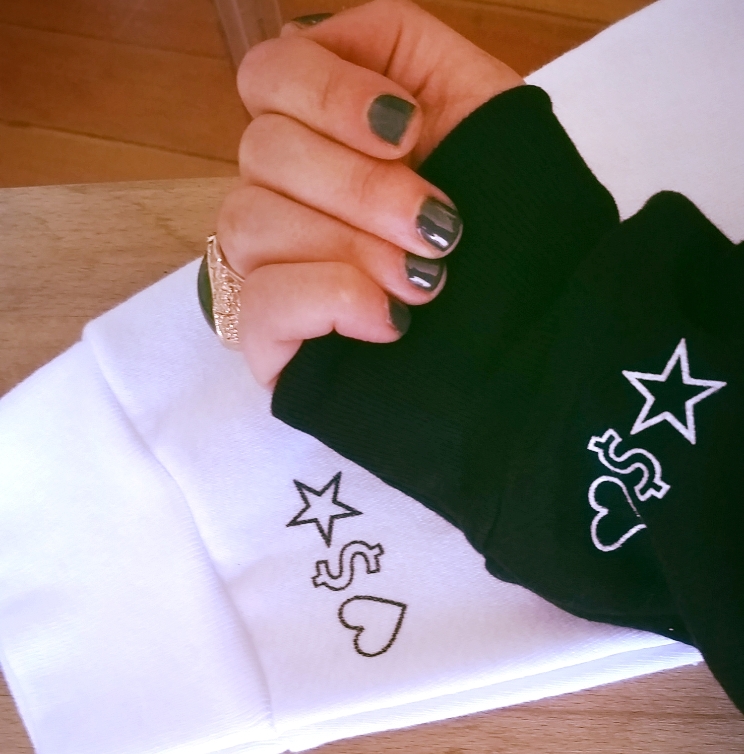 The  ♡ $ ☆  Special Edition Sweatsh*rt is available in black + white