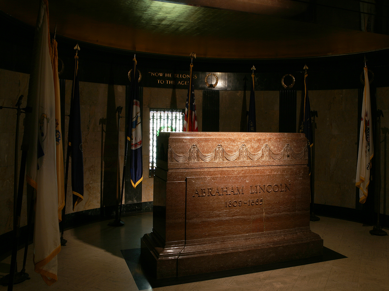 Lincoln's remains rest in a concrete vault ten feet below the marble floor of the burial chamber. A massive granite cenotaph marking the gravesite is flanked by the Presidential flag and flags of the states in which the Lincoln family resided. Rich Saal/The State Journal-Register