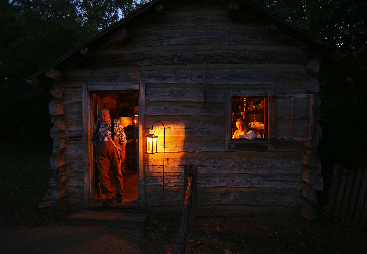 John Johnson, left, and John Blankenberger are volunteers in the Berry-Lincoln store at Lincoln's New Salem State Historic Site. The two were on hand for the annual candlelight tours in the village. Rich Saal/The State Journal-Register
