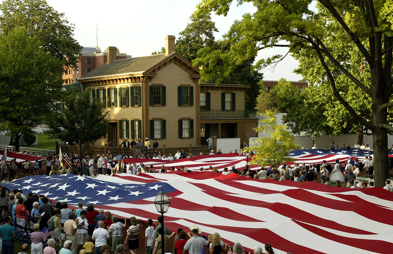 """Hundreds of residents turned out for an """"Honor Our Flag"""" ceremony in the Lincoln Home National Park and helped display three, 300 lb. American flags. File/The State Journal-Register"""