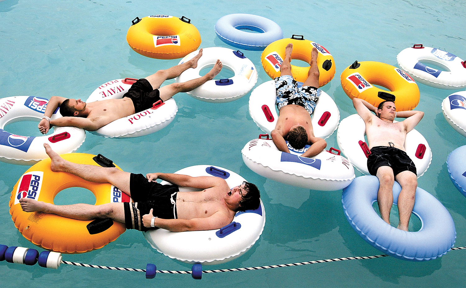 Springfield Rifles baseball players, from left, Joey Alesmeyer, Joe Hayden, Kellen Marshall and Joe Hulett take a day off from training to float in the wave pool at Knight's Action Park. Michael Brown/The State Journal-Register