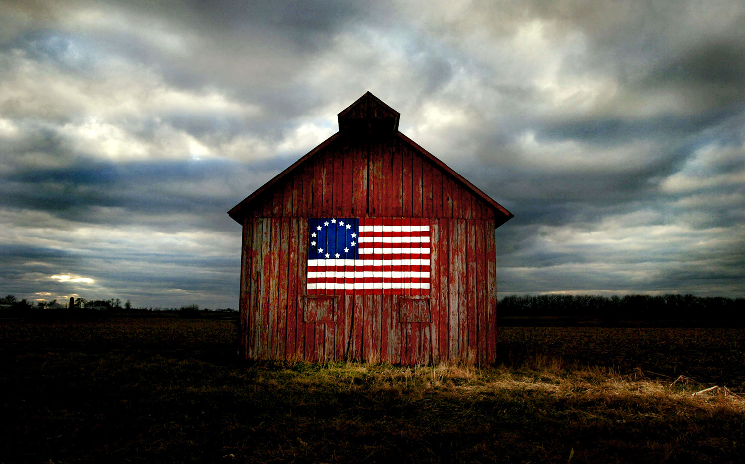 """The Wiese family barn stands braving storm clouds with a with a historic Besty Ross American Flag painted in rememberance of the September 11 attacks just north of Carlinville on Route 4. """"My son helped paint it to remember that day,"""" Gloria Wiese said. """"You wouldn't believe how many people stop and ask us about it."""" The Wiese family settlement dates back to 1853 in Macoupin County and the farm has been passed down through generations ever since.Pride on the prairie / The Wiese family barn, with a historic Betsy Ross American flag painted in remembrance of the Sept. 11 attacks, braves storm clouds Wednesday just north of Carlinville on Illinois 4. """"My son helped paint it to remember that day,"""" Gloria Wiese said. """"You wouldn't believe how many people stop and ask us about it."""" The Wiese family settlement dates to 1853 in Macoupin County, and the farm has been passed down through generations ever since."""