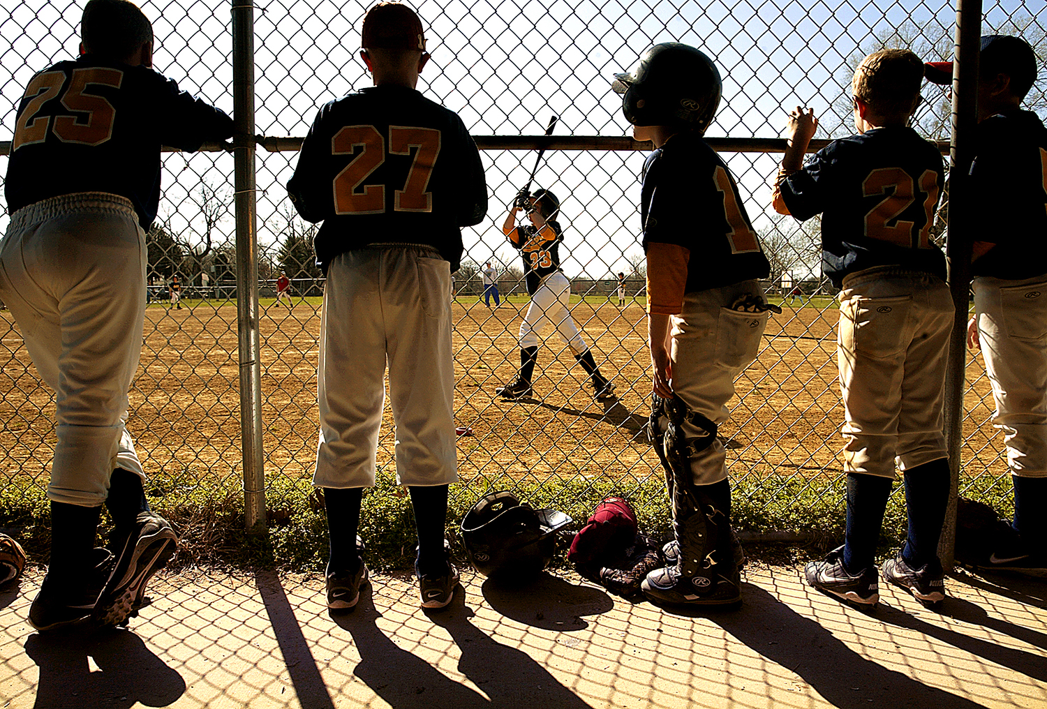 The Springfield Junior Astros watch from the dugout at Cy Young Little League Park as teammate Will Edge, 10, prepares for his turn at bat. T.J. Salsman/The State Journal-Register
