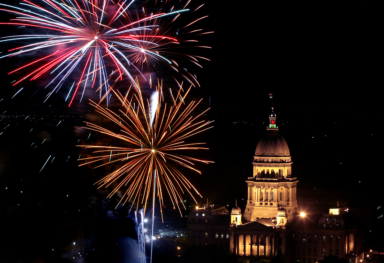 Fireworks light up the night in front of the Illinois State Capitol building celebrating the Forth of July.Fireworks light up the night in front of the Illinois State Capitol building celebrating the Forth of July.