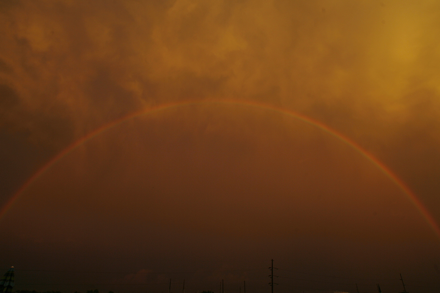A full rainbow appears in the sky above east Springfield after a rain shower Tuesday, July 10, 2007. Ted Schurter/The State Journal-Register
