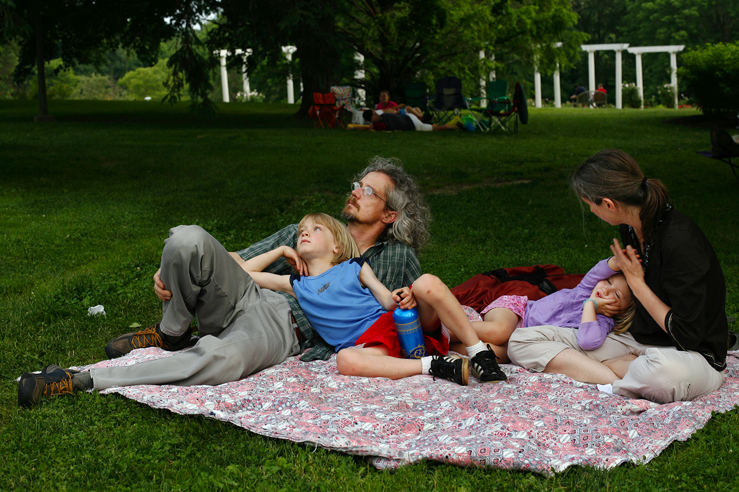 Michael and Angela Goebel-Bain listen to the carillon with their children Rowan, left, and Elsa during the 49th International Carillon Festival Friday, June 11, 2010 at Washington Park. Ted Schurter/The State Journal-Register