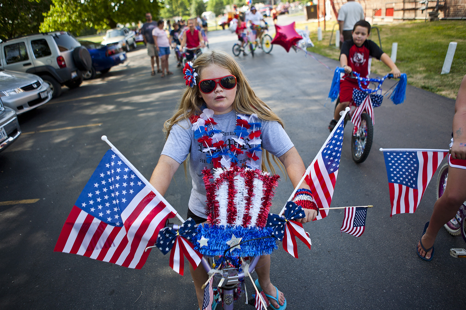 Haley Kennedy, 10, won first place in the bike decorating contest with her Independence Day inspired bicycle during the Fourth of July celebration parade, Wednesday, July 4, 2012, in Franklin, Ill. Franklin's Fourth of July celebration included a festival at Franklin Park with a basketball tournament along with the annual burgoo soup sale. Justin L. Fowler/The State Journal-Register