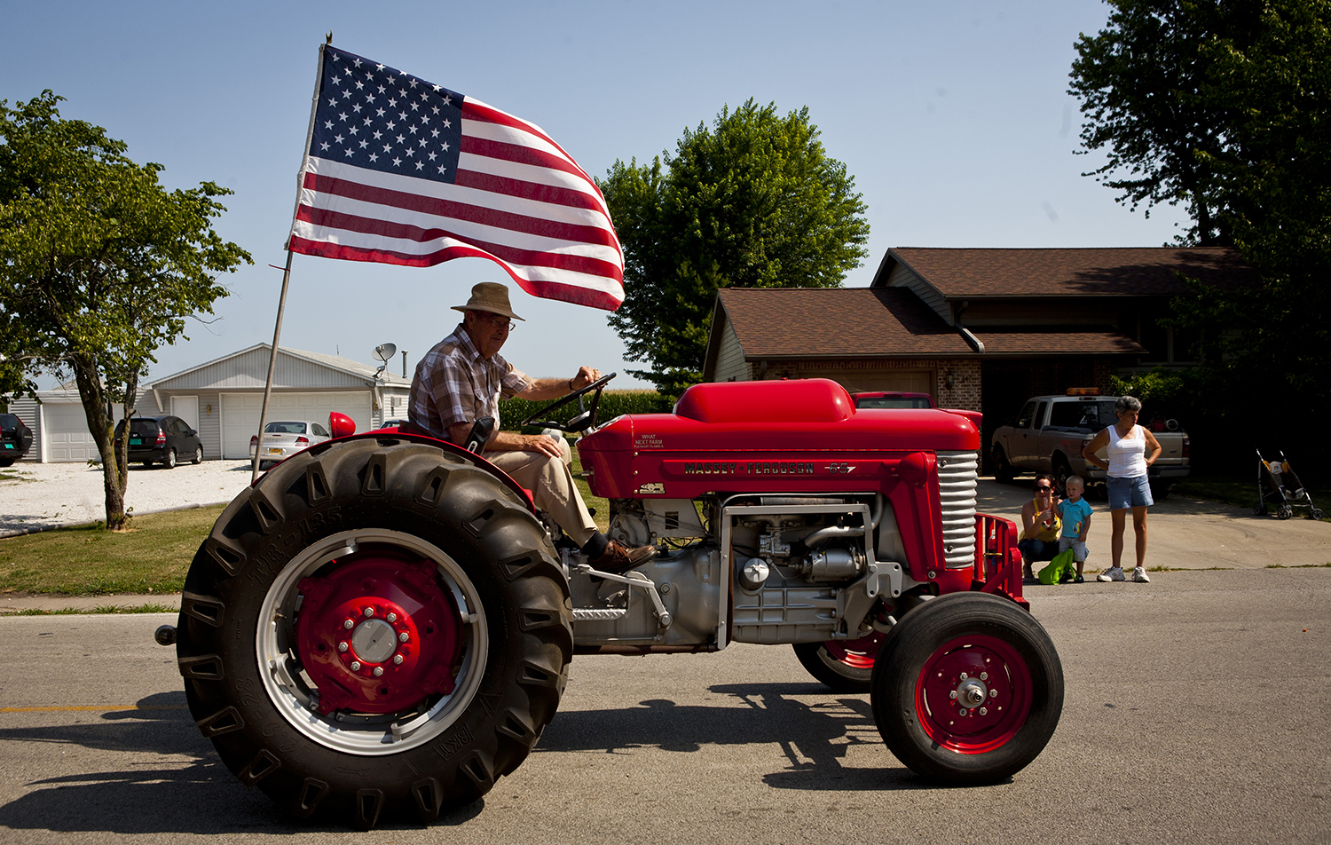 Russel Miner, pilots his 1963 Massey Ferguson LP antique tractor down Wyatt Avenue during the Fourth of July celebration parade, Wednesday, July 4, 2012, in Franklin, Ill. Franklin's Fourth of July celebration included a festival at Franklin Park with a basketball tournament along with the annual burgoo soup sale. Justin L. Fowler/The State Journal-Register