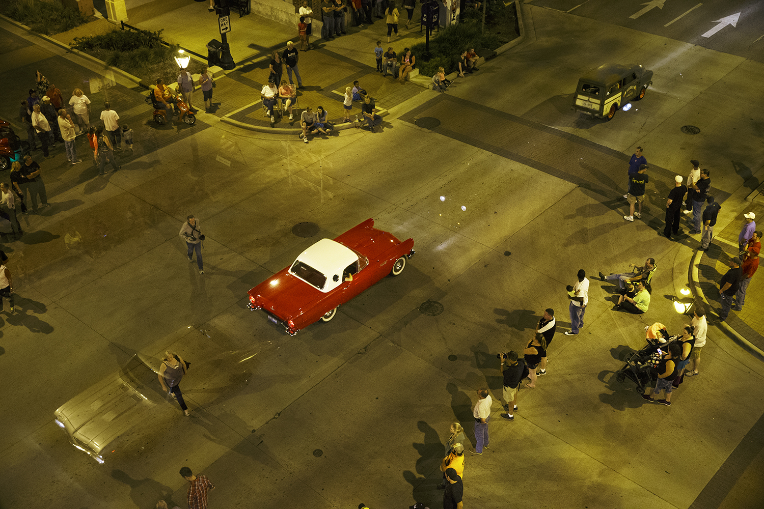 Cars parade down Sixth Street during the Route 66 Mother Road Festival cruise Friday, Sept. 26, 2014. Ted Schurter/The State Journal-Register