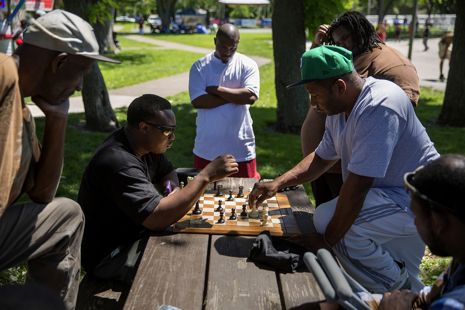 Portis Rice, left, and Eric Winkie Ellington face off across a chess board during the Juneteenth celebration at Comer Cox Park Saturday, June 14, 2014. Rich Saal/The State Journal-Register