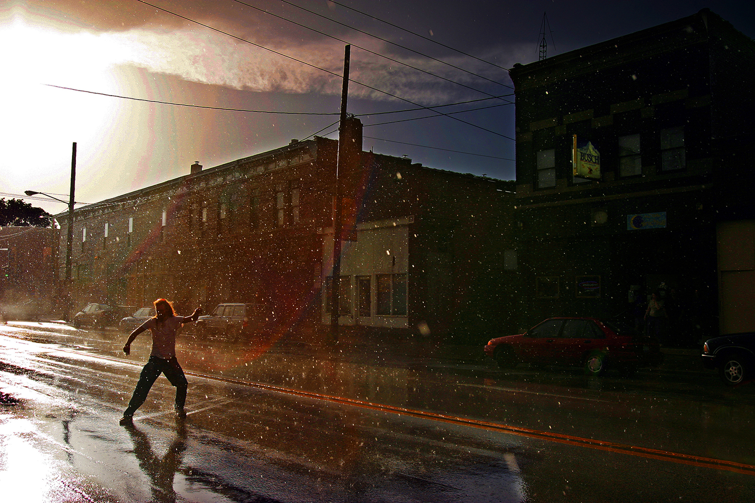 Rick Mari slides across a wet South Grand Avenue following a thunderstorm. Michael Brown/The State Journal-Register