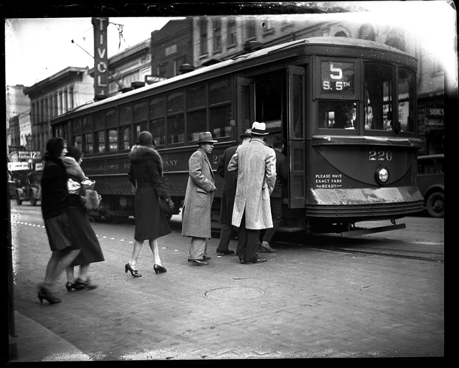 Passengers board street car on South Fifth Street in front of Tivoli Theater, Dec. 18, 1930. File/The State Journal-Register