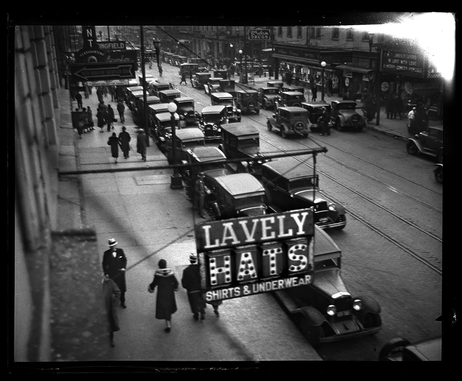 Monroe Street, looking west from Sixth Street. Image taken for advertising campaign promoting bus and street car system, public transportation, Dec. 16, 1930. File/The State Journal-Register