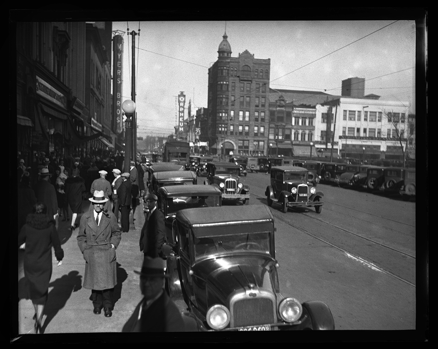 Fifth Street on the west side of public square, facing north from Adams Street. Myers Bros., Illinois National Bank, Orpheum Theater in distance, circa 1932. File/The State Journal-Register