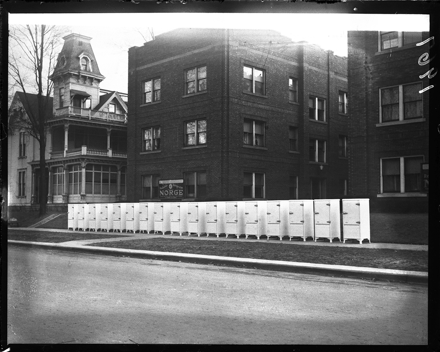 Plaza Apartment Building, 1008-1018 S. Seventh Street. Display of Norge refrigerators to be installed. J.T. Peters mansion at left, circa 1930. File/The State Journal-Register