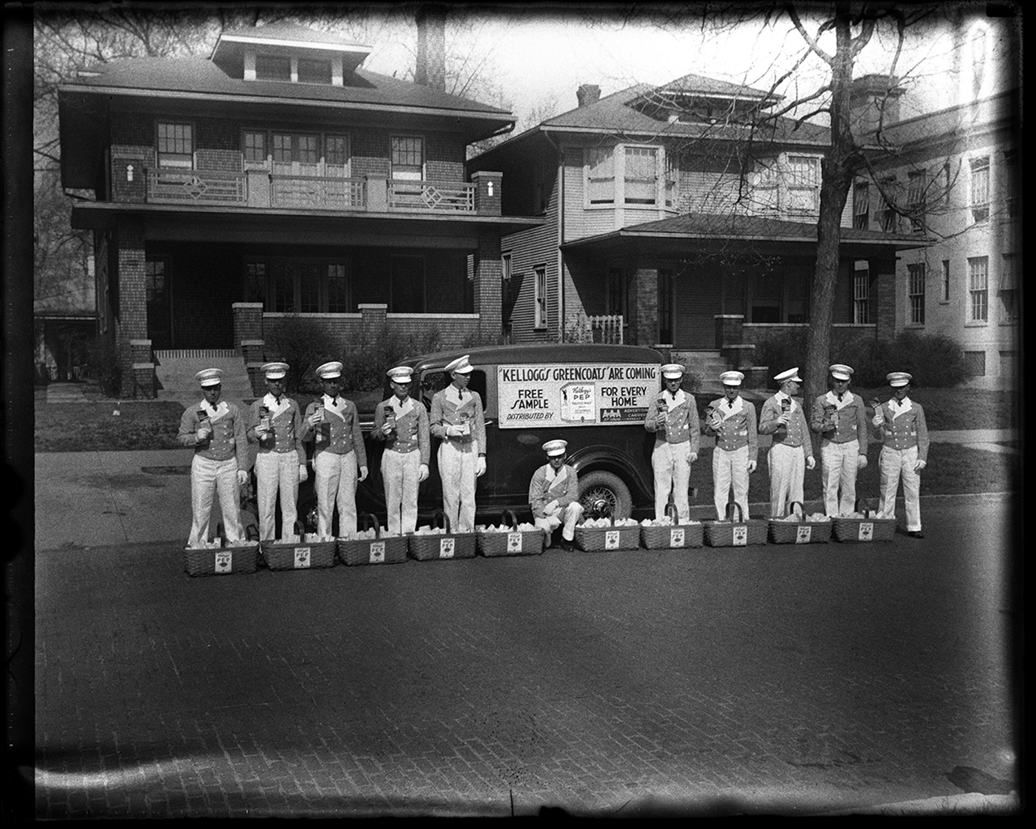Representatives of Kellogg's Cereal dressed in white trousers, green coats, white hats and gloves, distributed the company's new Pep cereal door to door in the 900 block of South Sixth Street on April 19, 1934. File/The State Journal-Register