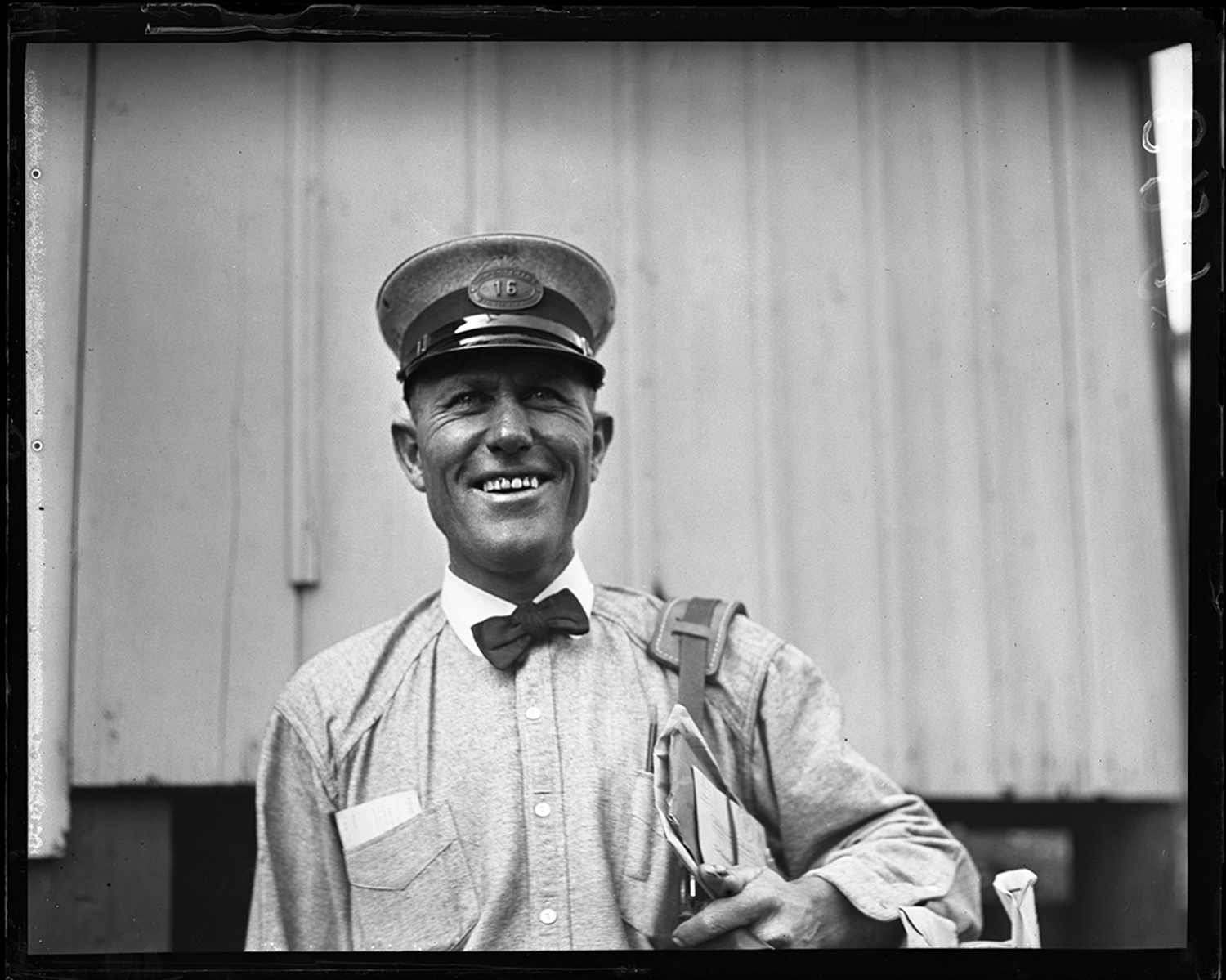 """C. W. Becker, postal carrier, delivered mail in the northwest section of the city. His portrait is from a """"smile of the day"""" contest held by the newspaper, published Oct. 17, 1930. File/ The State Journal-Register"""