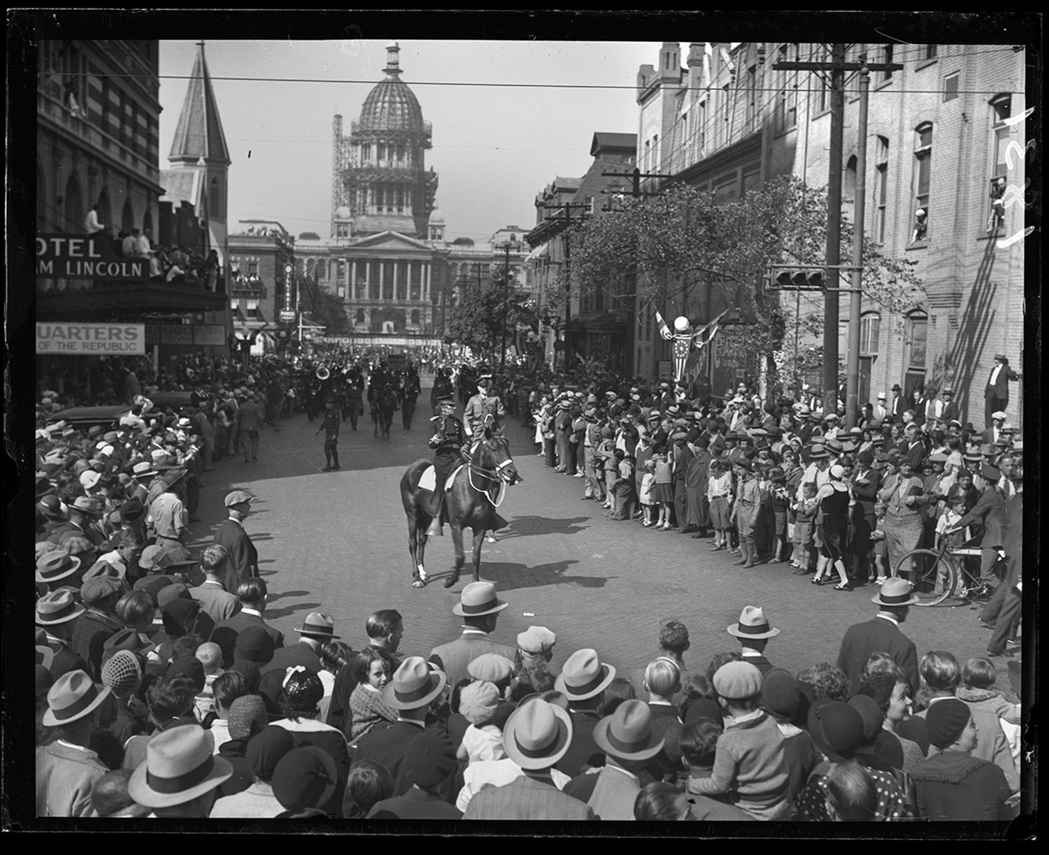 Grand Army of the Republic (G.A.R.) encampment and national convention Sept. 22, 1932. Parade on Capitol Avenue at Sixth Street, facing west toward capitol. Hotel Abraham Lincoln on left. Col. William J. Butler, grandson of Gen. John McClernand, leads the parade. File/The State Journal-Register