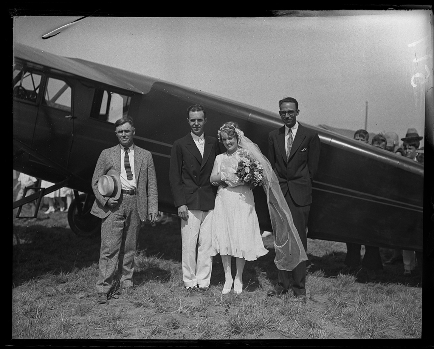 Wilson Briegel and Marian Robertson were married in an airplane, August 2, 1930. The Rev. Lewis Fisher, left, conducted the ceremony. Mrs. Briegel, mother of the groom, rode along and the pilot was Craig Isbell, right, at Southwest Airport.  File/The State Journal-Register