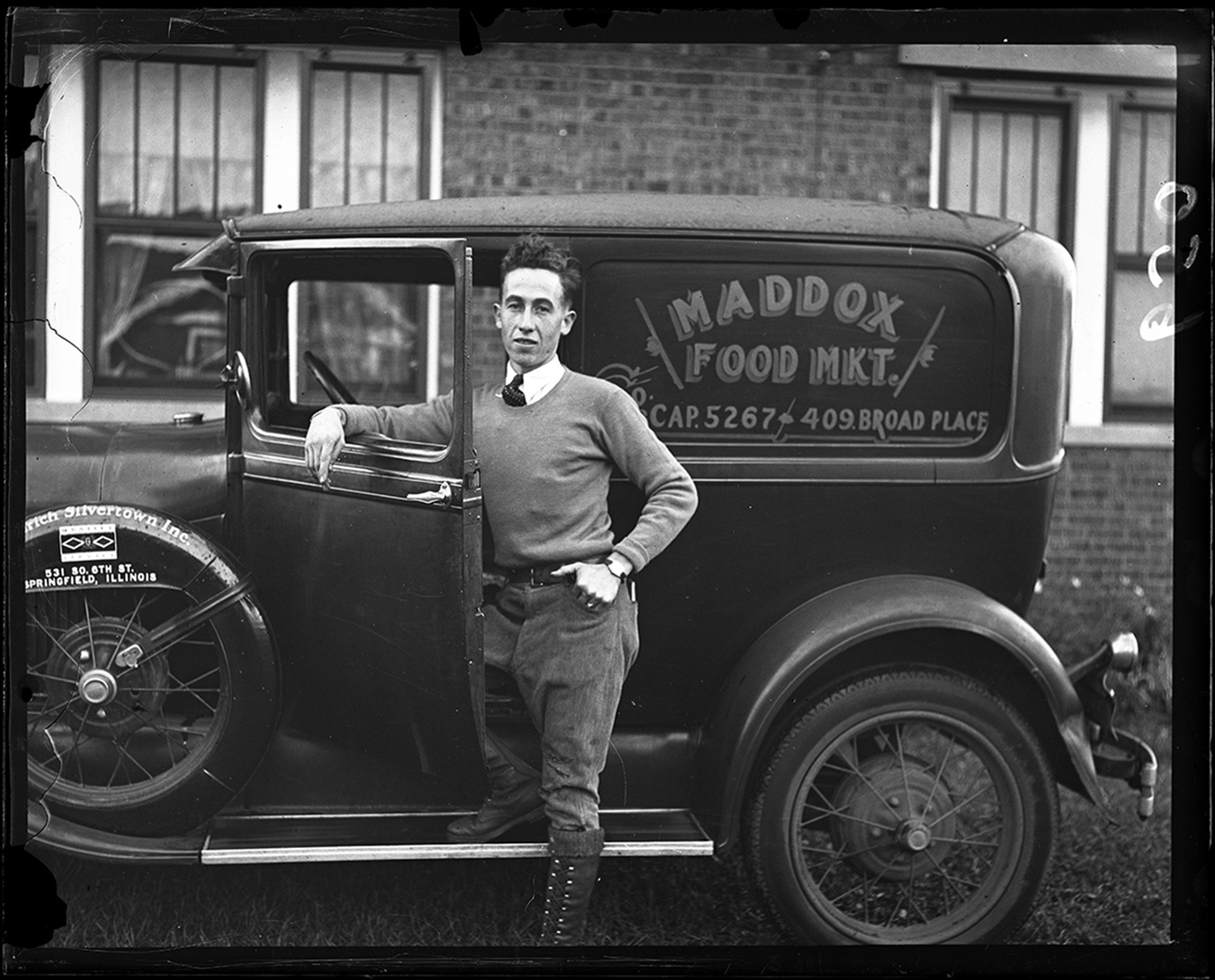 """Jimmy Minser is driver for Maddox Food Market.  """"Local Flyer, 20, is Driving Grocery Co. Truck While His Injured Leg is Healing""""  Minser, 20, was licensed co-pilot and had flown over 250,000 miles, Sept. 29, 1930. File/The State Journal-Register"""