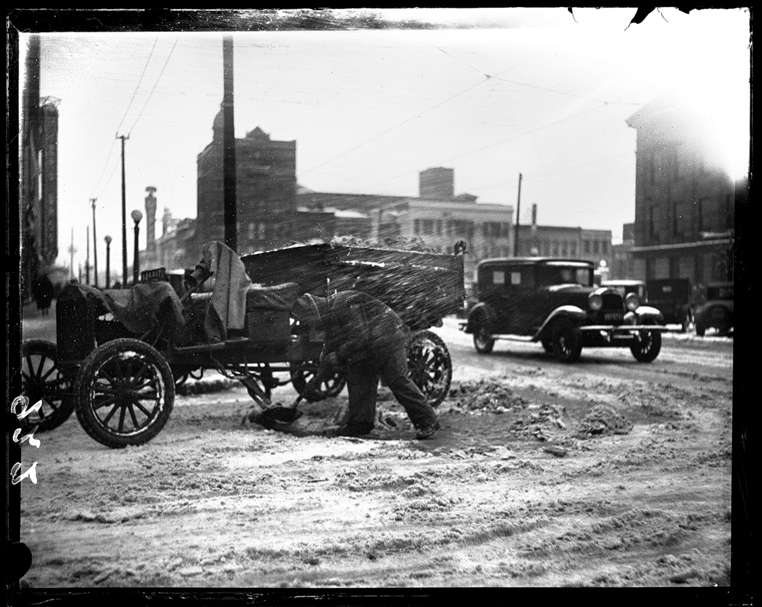 Fifty men from the Springfield city street department helped clear a 6-inch snowfall by hand from downtown intersections, March 6, 1931. This intersection is Fifth and Adams facing north. File/The State Journal-Register