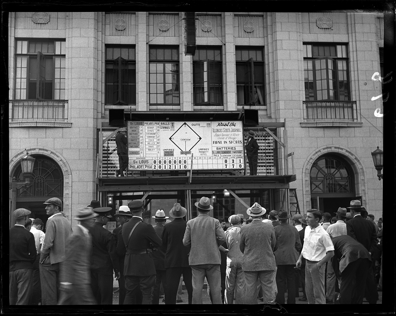Crowd gathered in front of Illinois State Journal building to watch score of the St. Louis Cardinals vs. Philadelphia Athletics game in the World Series, Oct. 1931. File/The State Journal-Register